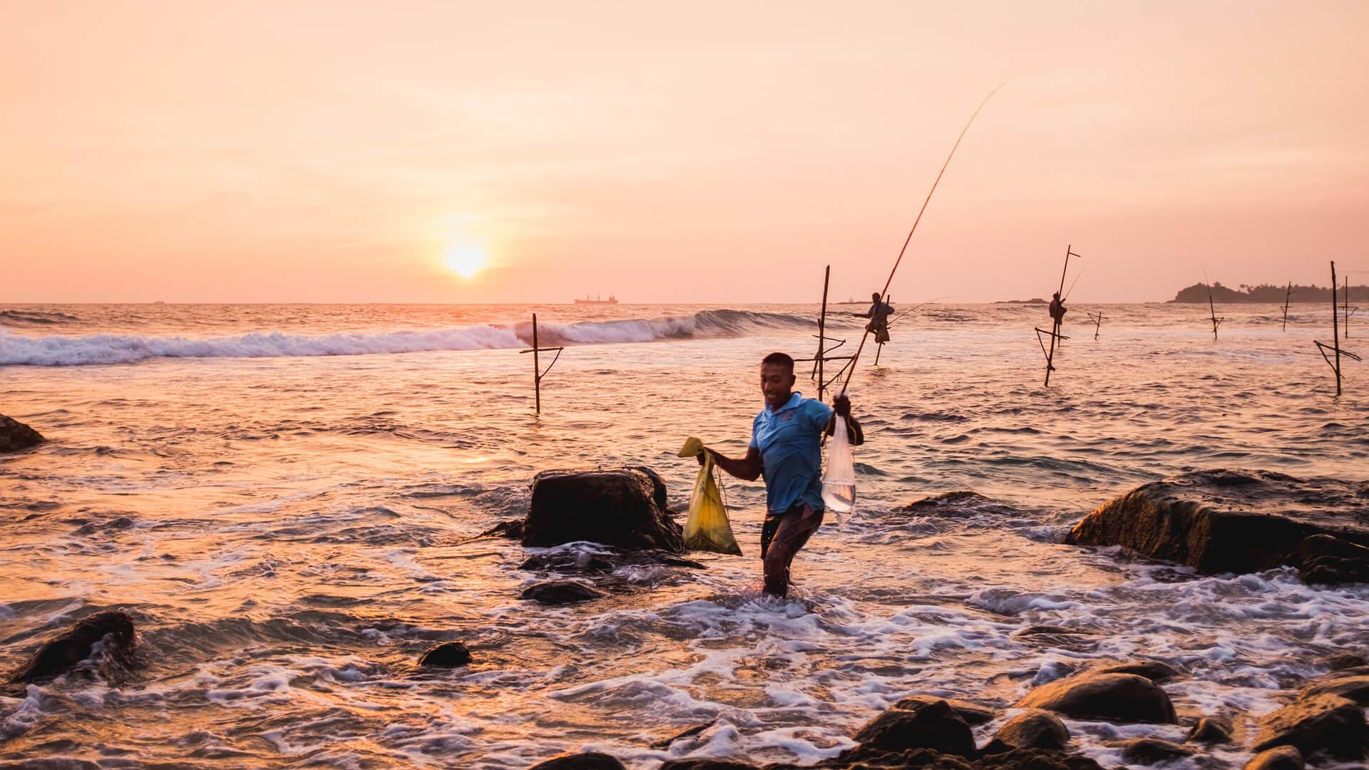 Pescadores ao por-do-sol